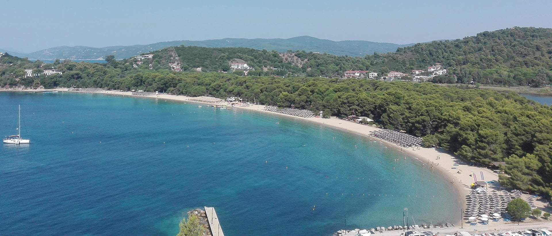An impressive verdant scenery on the most famous beach of Skiathos.