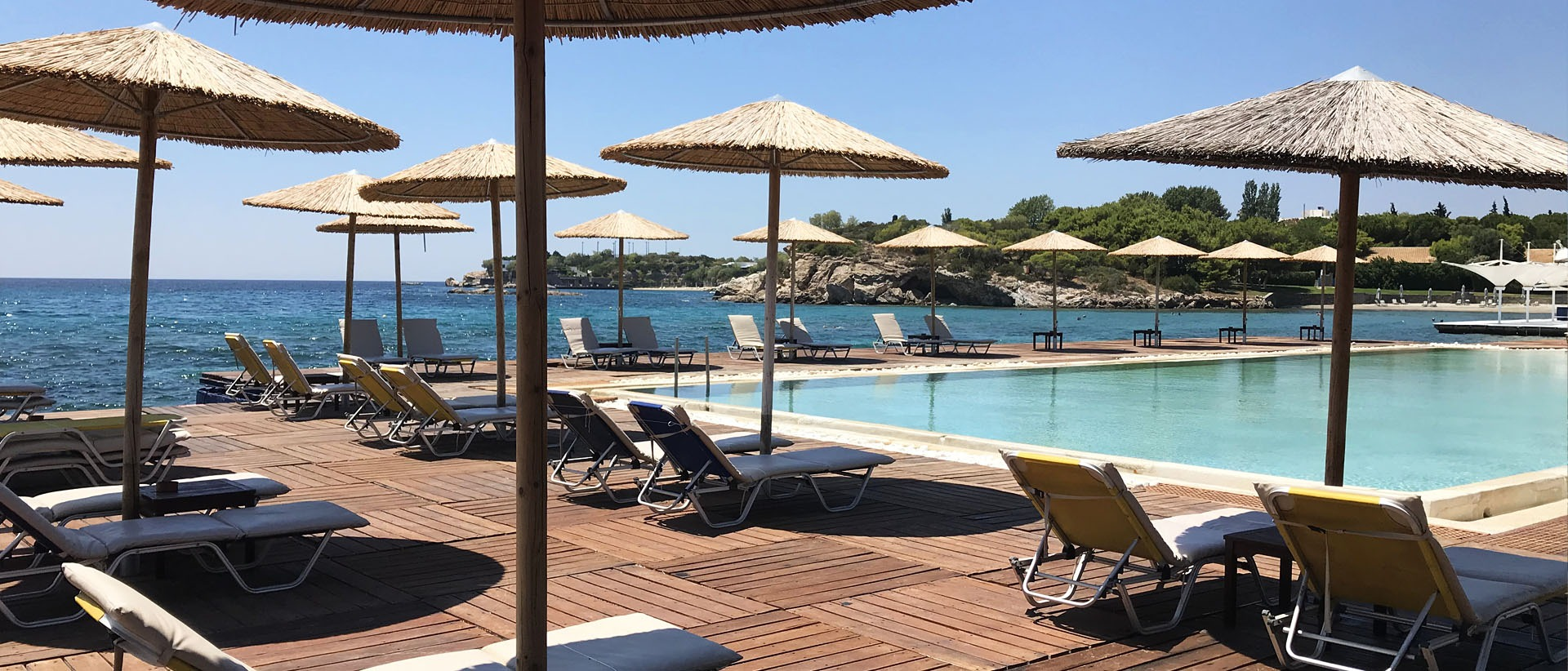 Experience the ultimate summer experience at Grand Beach Pool Lagonissi!